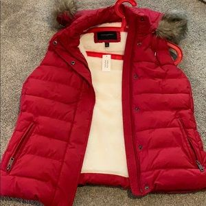 Never worn before, red vest!